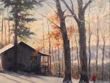cabin in snow with man walking next to trees