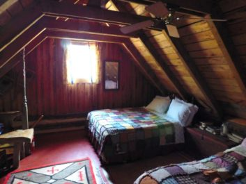 interior of cabin with beds with quilts