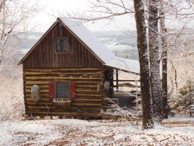 Aunt Phoebe's Perch Log Cabin in snow